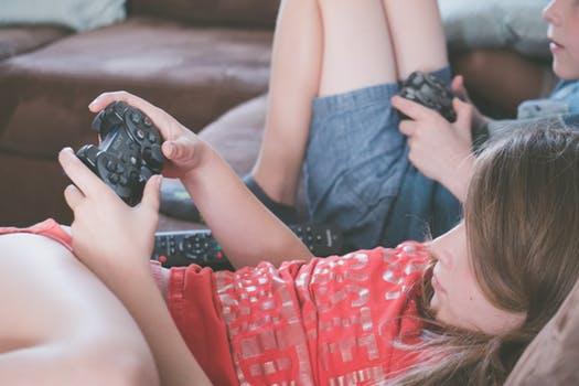 Kids playing video games. Gamers