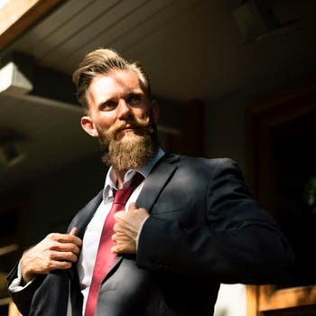 Villian computer hacker in a business suit with handlebar mustache